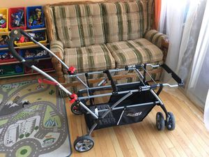 Double universal snap n go stroller for Sale in Alexandria, VA