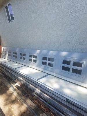 Sectional garage door parts/panels for Sale in Fresno, CA