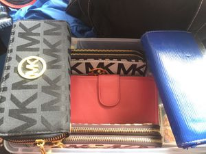Wallets *** MKors $35 new! Nuevo*. And pink is leather (cuero)$15 and blue one is $5 :) for Sale in Miami, FL