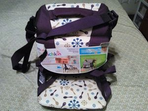 New munchkin travel booster seat w. Compartment for diapers..wipes..etc. for Sale in Nashville, TN