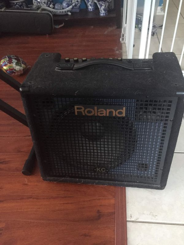 Roland keyboard and amplifier