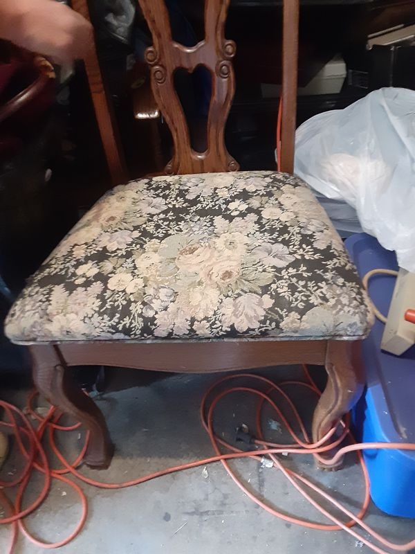 Antique solid wood with floral feet and high backing best offer