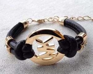 2 MK Bracelets, Black and White for Sale in Potomac Falls, VA