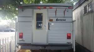 Camper loaded with toilet, fridge, queen bed, sink, kitchen table and fold out twin bed for Sale in Rio Rancho, NM