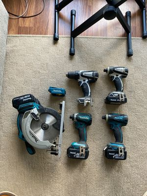 Makita phone charger, 3 impact guns, 1 drill and cordless skillsaw. for Sale in South San Francisco, CA
