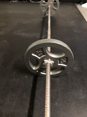Barbell Standard straight bar with 25 pound weights.$115OBO... for Sale in Glendale, AZ