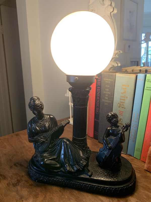 Lady and small girl playing instruments lamp