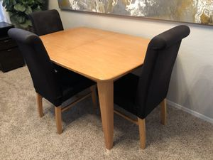 Cute kitchen table with leaf extension and 3 black chairs for Sale in Gilbert, AZ