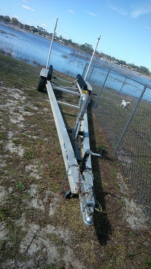 Great condition dual axle aluminum boat trailer, LED lights good tires ready to go for Sale in Deltona, FL
