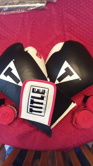 Title Gel World Bag Boxing Gloves with 4 hand wraps for Sale in Durham, NC