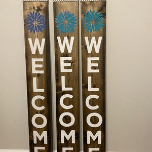 Solid wood welcome signs. 5ft x 7 inches wide 1 inch thick. Jacobean stain, welcome in white chalk paste, flower accent in blue, lavender/teal, or tea for Sale in Riverview, FL