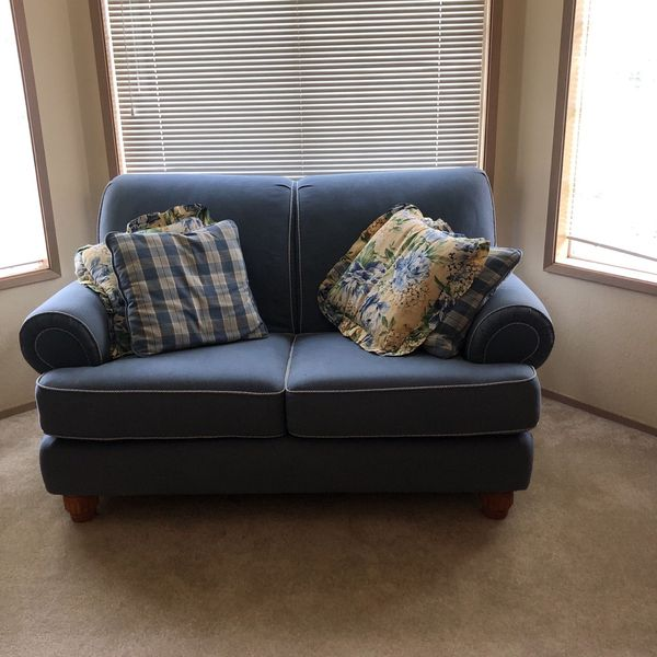 Love Seat, Great Condition With 4 Pillows. Light blue with Light Yellow Floral Accent Pillows.