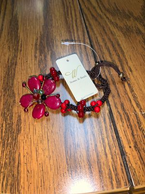 A brand new stone & and bead bracelet red and adjust for all size wrist I payed 10 accepting 5 for Sale in Murfreesboro, TN