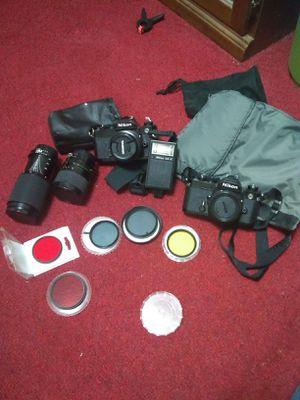 Nikon camera's 3 lenses and color filtors for Sale in Minneapolis, MN
