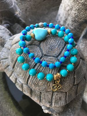 Turquoise stretch bracelets with om charm size 7.5 inches for Sale in Stockton, CA