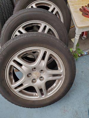 "16""rims and tires good condition 5lugs for subaru $375 for Sale in Cerritos, CA"