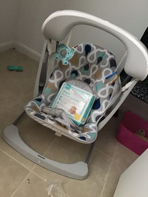 Fisher price cradle swing with free pack of newborn diapers (medline) for Sale in Columbia, SC
