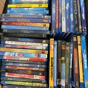 Disney & more movies collection + free blue ray player and cd. rack for Sale in Miami, FL