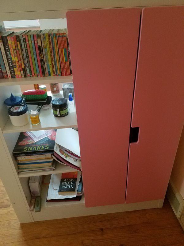 IKEA Kids Loft Bed with 2 drawers, 2 doors, book shelves , desk, wardrobe.