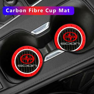 BRAND NEW 2PCS SCION RED RUBBER CAR CUP COASTER MAT WITH REAL CARBON FIBER EMBLEM for Sale in City of Industry, CA
