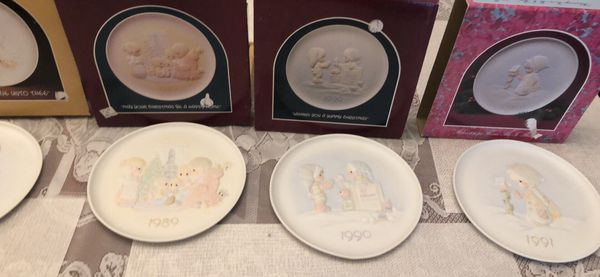 Precious moments plates have paper work
