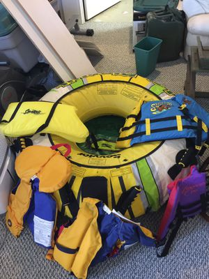 Ski boat tow inflatable and kids life jackets for Sale in Peachtree Corners, GA
