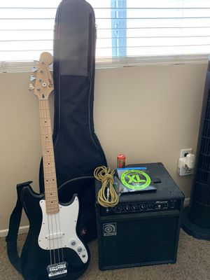 Brand New Squire Bronco Bass by Fender with everything included! From the Amp, guitar strap, the chord, string cleaner, extra strings and guitar bag. for Sale in Desert Hot Springs, CA