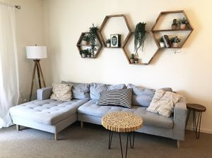 Grey sectional sofa tufted fringe pillows target gold wood lamp wood brown tan round black pin coffee table side tv console stand hexagon wall shelf for Sale in Oakland, CA