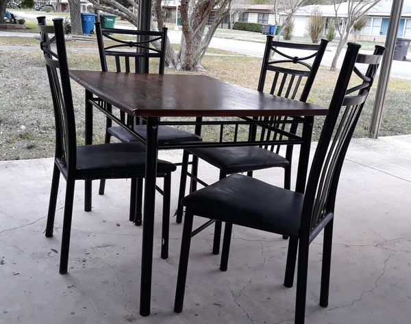 Dining Room Table With Four Black Metal Frame Chairs For