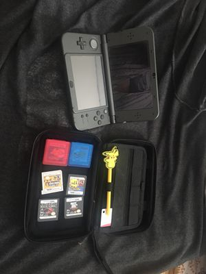 Nintendo 3DS XL with case and 4 games for Sale in Tampa, FL
