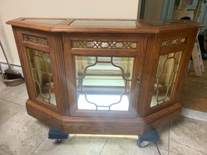 """Traditional style glass/mirrored showcase. (TV stand). 48""""W x 15""""D x 29""""H Good condition for Sale in Staten Island, NY"""