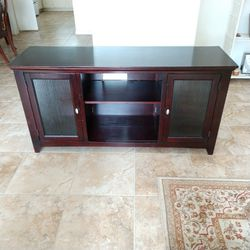 Sturdy entertainment center tv table cabinet with privacy glass door strong cherry color for Sale in Stafford,  TX