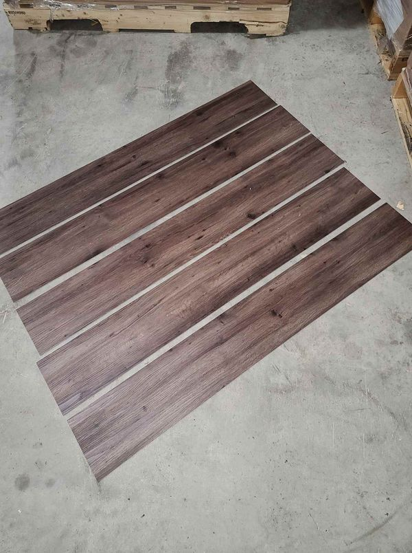 Luxury vinyl flooring!!! Only .65 cents a sq ft!! Liquidation close out! T0