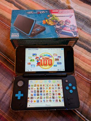 Black Nintendo new 2ds xl with 130 3ds games , ds , 2ds , 64gb for Sale in Los Angeles, CA