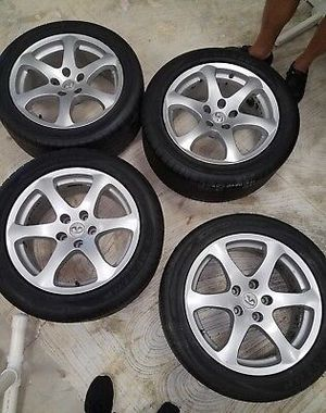 Infinity stock rims with all 4 tires for Sale in Phoenix, AZ