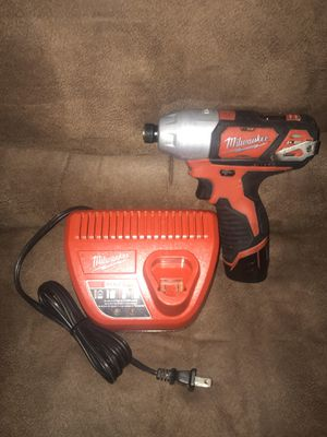 Milwaukee m12 impact drill one battery and charger for Sale in Clayton, NC