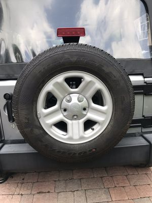 Jeep Wrangler jk unlimited sport wheels and tires for sale for Sale in SUNNY ISL BCH, FL