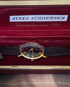 VINTAGE SOLID GOLD 14k. Jules Jurgensen Swiss made hand winding watch. 36mm. Box, paperwork and certificate of guaranty. Working well. Looks like new. for Sale in West Miami, FL