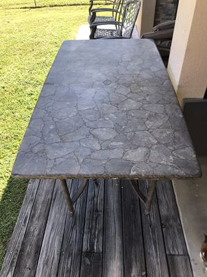 Stone patio table for Sale in Port St. Lucie, FL