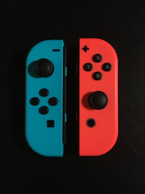 Pair of neon red/blue joy-cons for Nintendo Switch for Sale in Seattle, WA