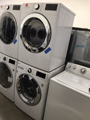 NEW WHITE LG WASHER AND GAS DRYER WITH A BIG CAPACITY for Sale in Los Angeles, CA