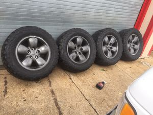 "4- Dodge Ram 20 inch Rims with 35"" inch tires, 2 have minimal tread on them and the other 2 have virtually no tread left on them. Priced to sell at 1 for Sale in East Meadow, NY"