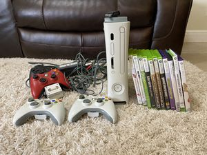 XBOX 360 with games, wireless network adaptor, controllers, and chargers for Sale in Miami, FL