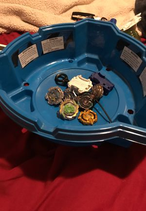 6 beyblades 2 Launchers and the base for 32 for Sale in Riverside, CA