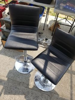 2 leather and chrome hydraulic swivel chairs fully functional nice shape 50.00 for the pair for Sale in La Mirada,  CA