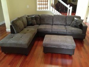 Grey microfiber sectional couch and ottoman for Sale in SeaTac, WA