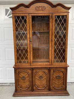Selling A Glass Hutch With Two Shelves , And Two Bottom Doors With Shelves for Sale in Corona,  CA
