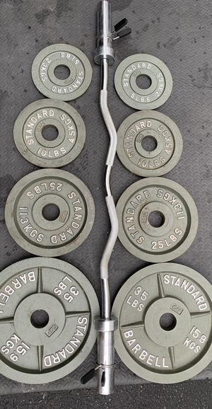 Olympic standard weights plates and curl bar for Sale in Kent, WA