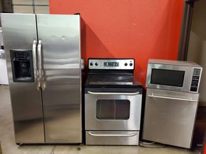 Stainless steel appliances set fridge stove dishwasher microwave all good working conditions set for $599 for Sale in Denver, CO