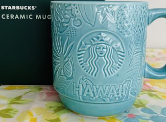 4 available- 2020 Starbucks HAWAII Exclusive collection Coffee Mug. Brand New In Box. Beautiful aqua color embossed with florals and fruit. for Sale in Lakewood,  WA